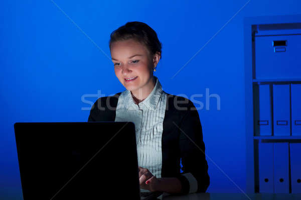 portrait of a woman in a night office Stock photo © adam121
