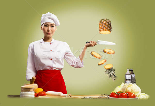 Asian female chef cuts pineapple Stock photo © adam121