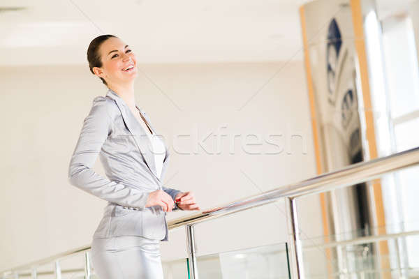Business woman standing in the lobby of the office Stock photo © adam121