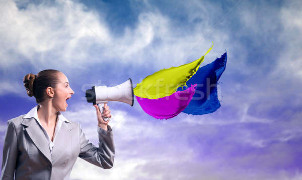 business woman cooks shouting into a megaphone Stock photo © adam121
