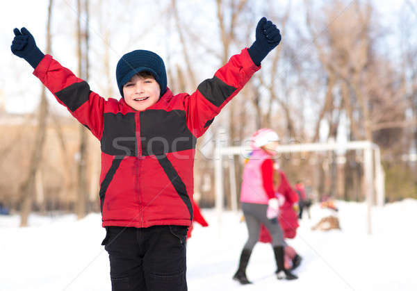boy in winter park raised his hand Stock photo © adam121
