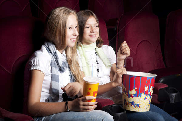 two beautiful girls watching a movie at the cinema Stock photo © adam121