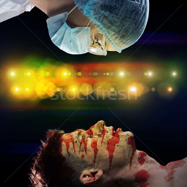 wounded man and the doctor Stock photo © adam121