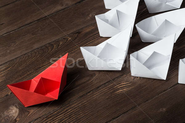 Business leadership concept with white and color paper boats on wooden table Stock photo © adam121