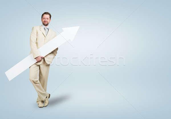 Businessman with arrow Stock photo © adam121