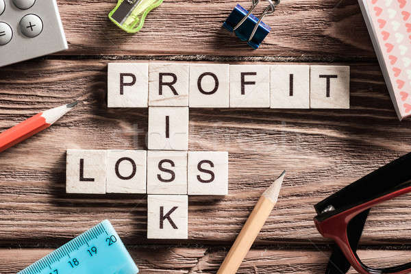 Profit loss and risk words on workplace collected of wooden cubes Stock photo © adam121