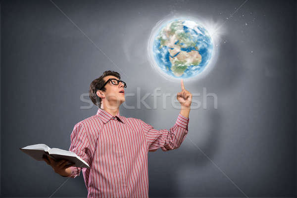 young man with a book thinks Stock photo © adam121