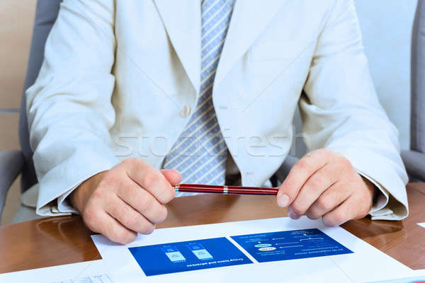 Stock photo: businessman holding a pen in hand