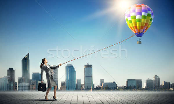 Woman catch balloon Stock photo © adam121