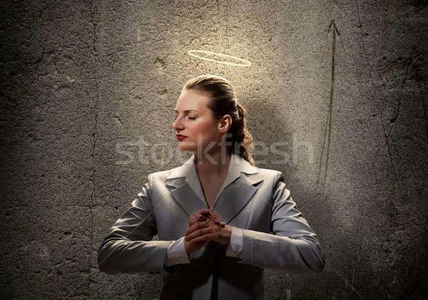 Santo imprenditrice giovani luce sopra testa Foto d'archivio © adam121