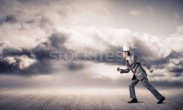 King businessman in elegant suit running and blue sky at backgro Stock photo © adam121