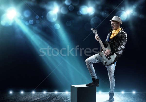 Rocksztár színpad fiatalember kő zenész fények Stock fotó © adam121