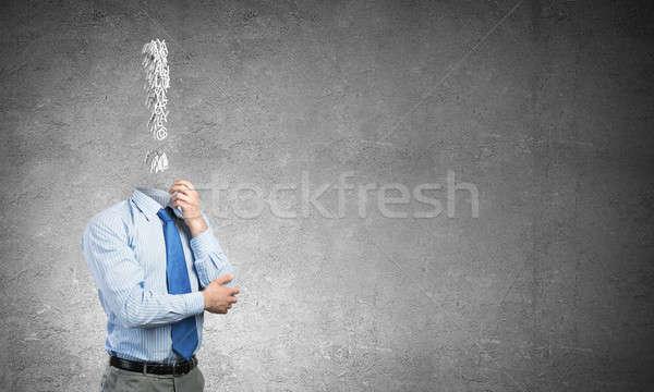 Pensive headless businessman Stock photo © adam121