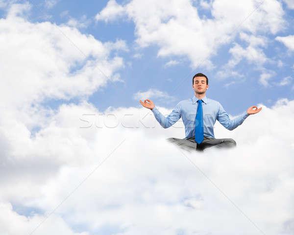 Zdjęcia stock: Człowiek · biznesu · obraz · biznesmen · chmury · niebo