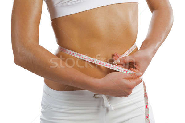 young athletic woman measuring waist Stock photo © adam121