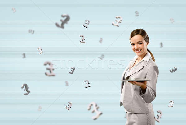business woman holding a tablet and smile Stock photo © adam121