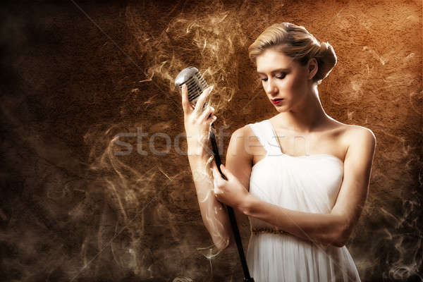 Mooie blonde vrouw zanger microfoon rond Stockfoto © adam121
