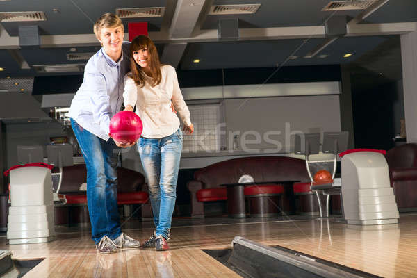 Bowling Guy jouer ensemble femme Photo stock © adam121