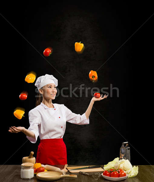 Asian woman chef juggling with vegetables Stock photo © adam121