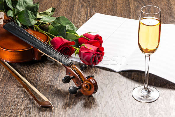 Violin, rose, glass of champagne and music books Stock photo © adam121