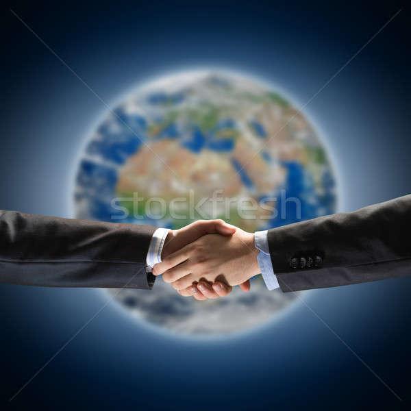 Stretta di mano due imprenditori pianeta terra elementi immagine Foto d'archivio © adam121