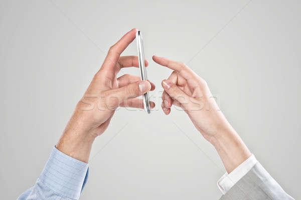 Trabalhando coesão pessoas de negócios mãos telefone móvel Foto stock © adam121