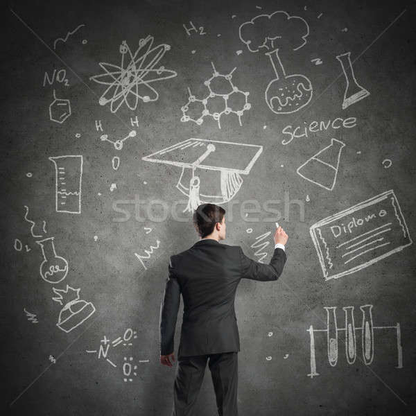 Wetenschapper schrijven formules schoolbord jonge man pak Stockfoto © adam121