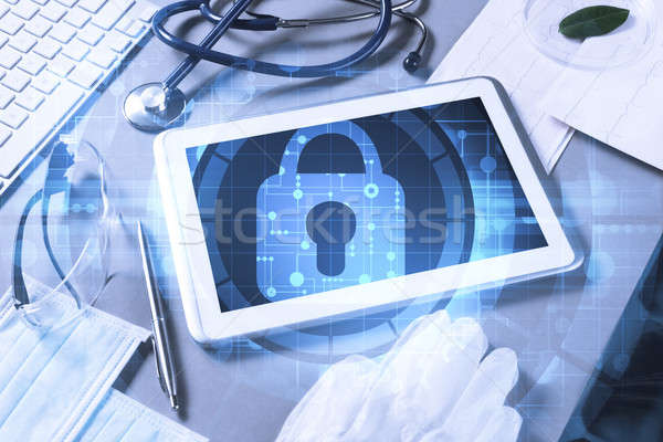 Top view of doctor workplace with tablet pc and medicine tools o Stock photo © adam121