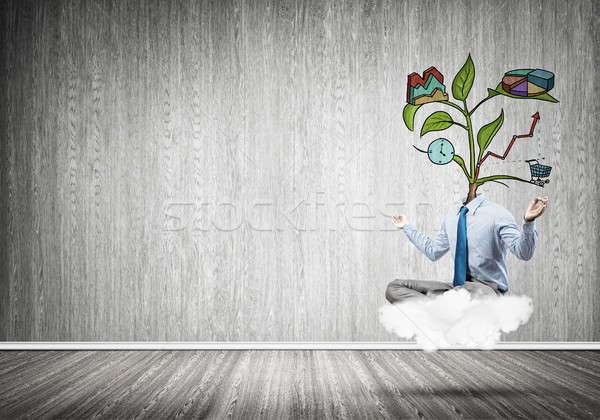 Headless businessman meditating Stock photo © adam121