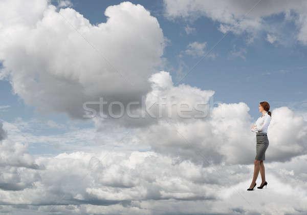 деловая женщина белый облаке улыбаясь небе Постоянный Сток-фото © adam121