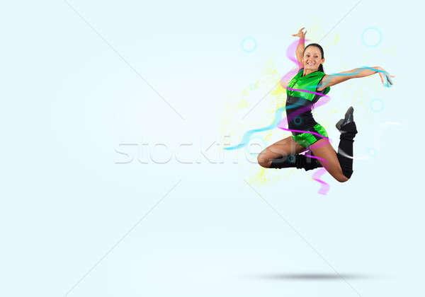 Chefe de torcida menina jovem belo saltando Foto stock © adam121