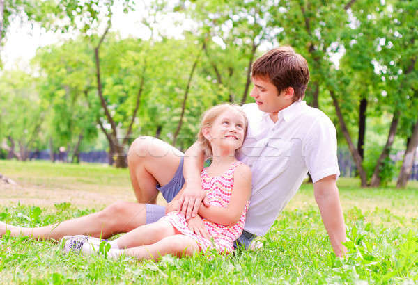 Father and daughter sitting together on the grass Stock photo © adam121