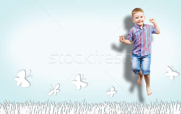 boy jumping on the background of painted wall Stock photo © adam121