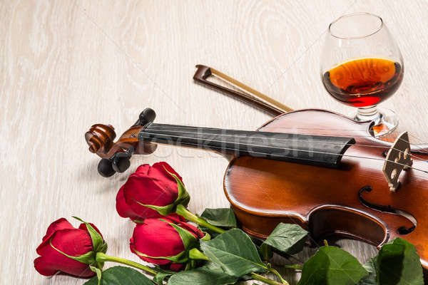 Violin, rose, glass and music books Stock photo © adam121