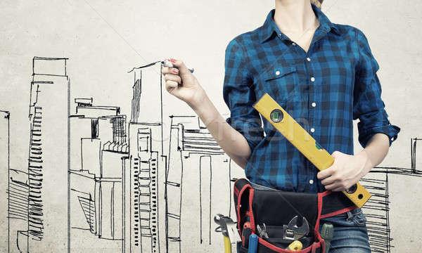 Woman engineer sketching her ideas Stock photo © adam121