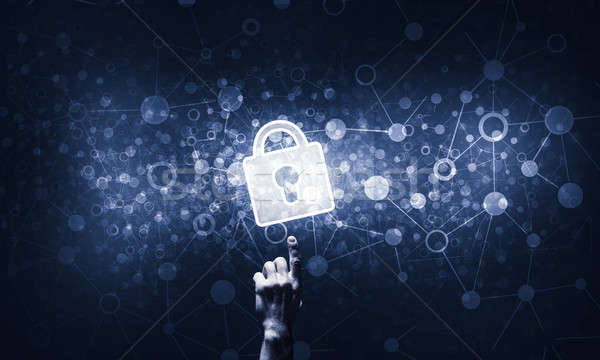 Hand pointing with finger at padlock as concept of internet secu Stock photo © adam121