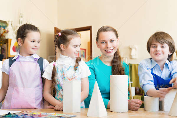 children with the teacher engaged in painting Stock photo © adam121