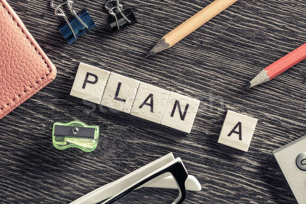 Conceptual business keywords on table with elements of game making words plan a Stock photo © adam121