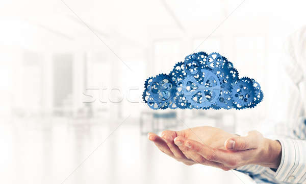 Man presenting in his palms cloud computing concept as mechanism Stock photo © adam121