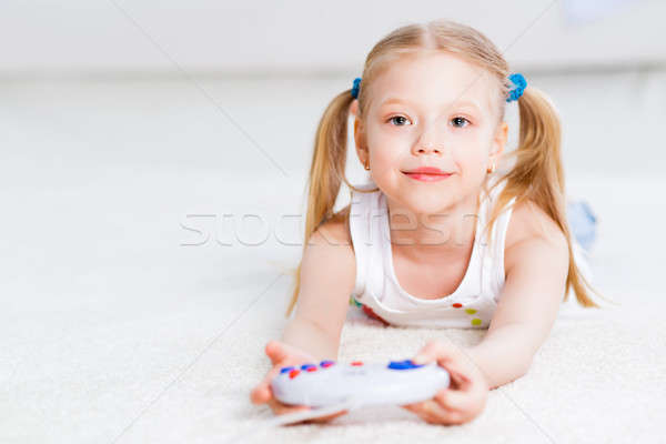 girl playing on a game console Stock photo © adam121