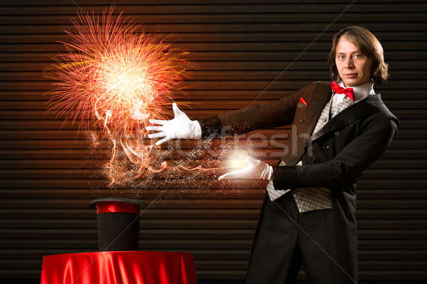 magician causes the magic out of the hat Stock photo © adam121
