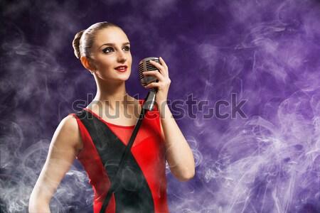 Vonzó nő énekes mikrofon mögött absztrakt divat Stock fotó © adam121