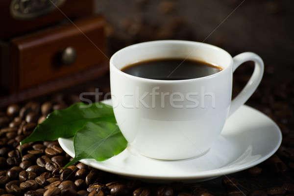 Кубок черный кофе зеленые листья кофе вокруг искусства Сток-фото © adam121