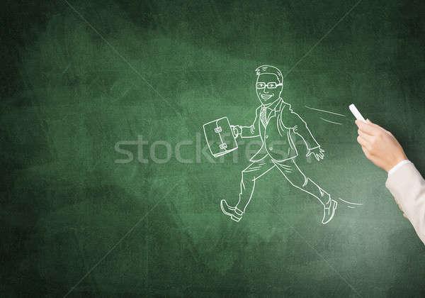 Caricatures of happy businessman Stock photo © adam121