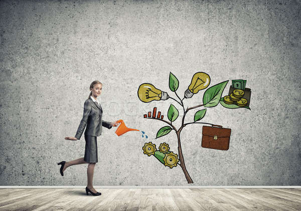 Young businesswoman in empty room watering drawn growth concept  Stock photo © adam121