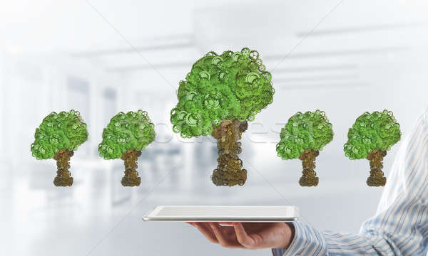 Eco green environment concept presented by tree as working mechanism or engine Stock photo © adam121