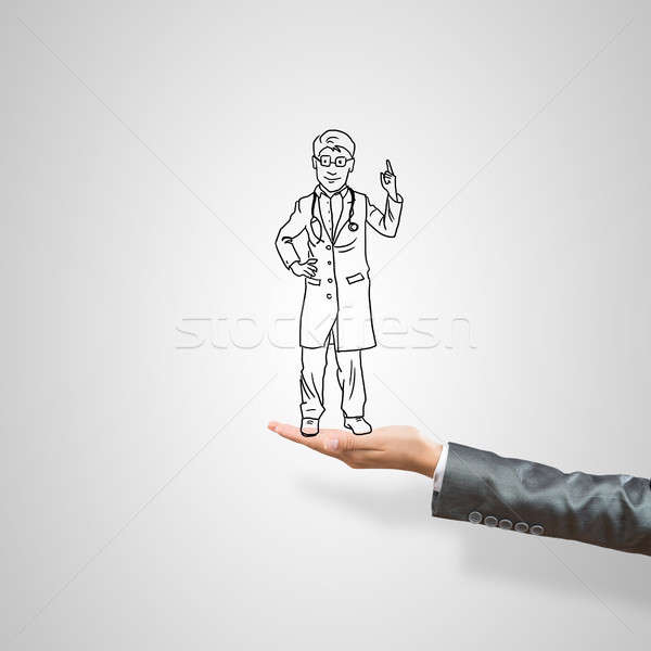 Caricatures of businessman in palm Stock photo © adam121