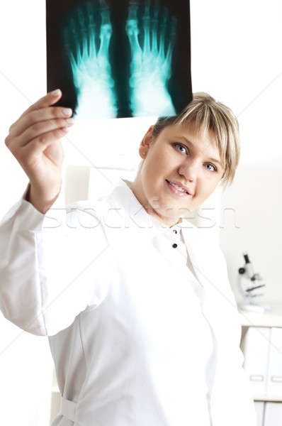 Female medic looking at x-rays Stock photo © adam121