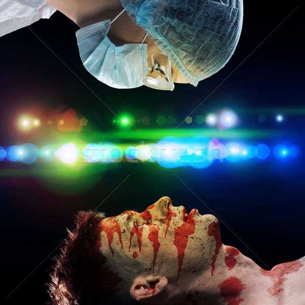 Ranny człowiek lekarza obraz pierwsza pomoc zdrowia Zdjęcia stock © adam121
