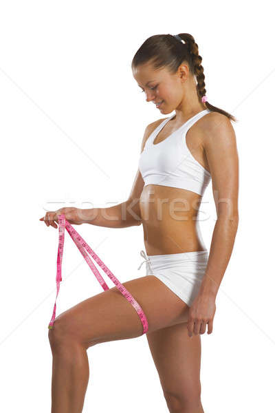 athletic woman measuring thigh Stock photo © adam121